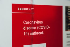 Emergency red sign about Coronavirus disease outbreak