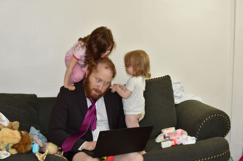 Remote dad trying to work with his daughters around