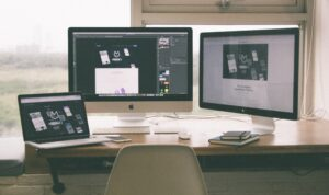Computer monitors on a desk