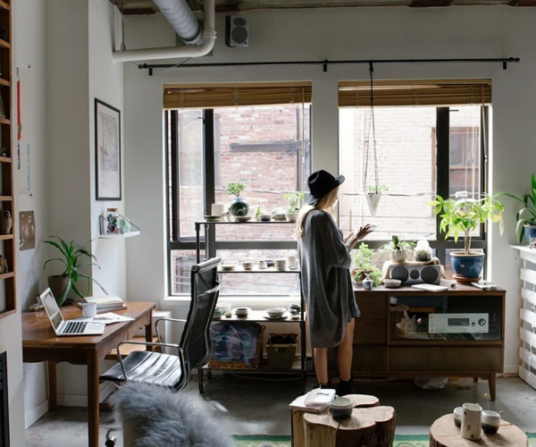 Woman staring at her window in her home office
