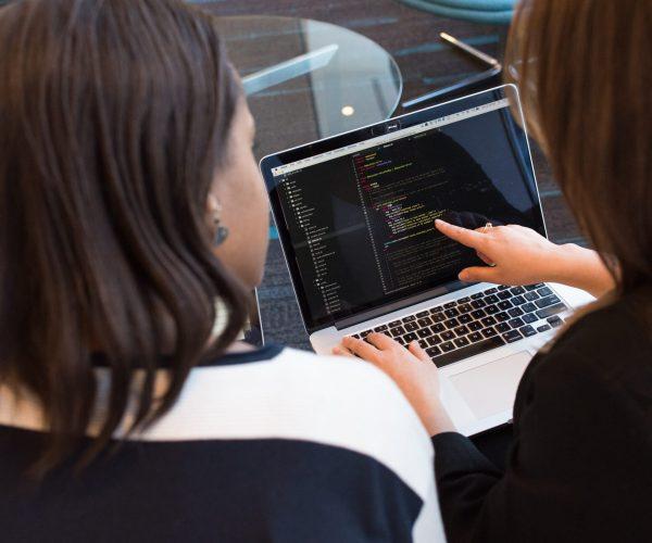 Women coding in laptop